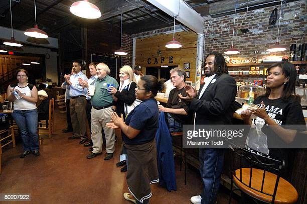Supporters of Democratic presidential hopeful Sen Barack Obama watch the Mississippi primary results at a coffee house March 11 2008 in Meridian...