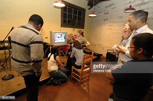 Supporters of Democratic presidential hopeful Sen Barack Obama watch the Mississippi primary results March 11 2008 in Meridian Mississippi The...