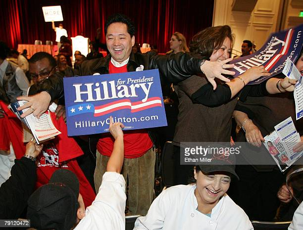 Supporters of Democratic presidential hopeful Sen Hillary Clinton cover up a supporter of Democratic presidential hopeful Sen Barack Obama before the...