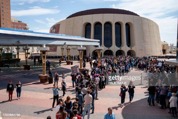 Supporters of Democratic presidential hopeful Vermont Senator Bernie Sanders line up outside the Abraham Chavez Theater for his campaign rally on...