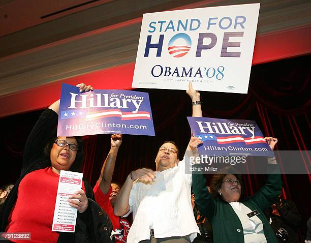 Supporters of Democratic presidential hopefuls Sen Hillary Clinton and Sen Barack Obama hold up signs before the start of a caucus at the Bellagio...