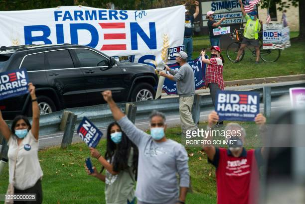 Supporters of Democratic presidential nominee and former Vice President Joe Biden cheer him on as he arrives at a plumbers union training center in...