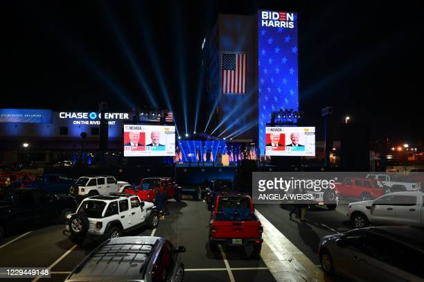 Supporters of Democratic presidential nominee and former Vice President Joe Biden watch election results outside the Chase Center in Wilmington,...