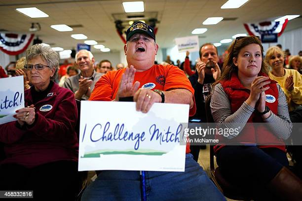 Supporters of Democratic Senate candidate and Kentucky Secretary of State Alison Lundergan Grimes cheer while Grimes speaks at a campaign stop at the...