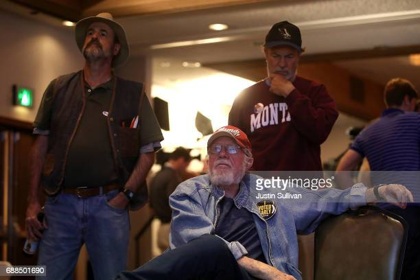 Supporters of Democratic US Congresstional candidate Rob Quist watch election returns during an election night gathering at the DoubleTree by Hilton...