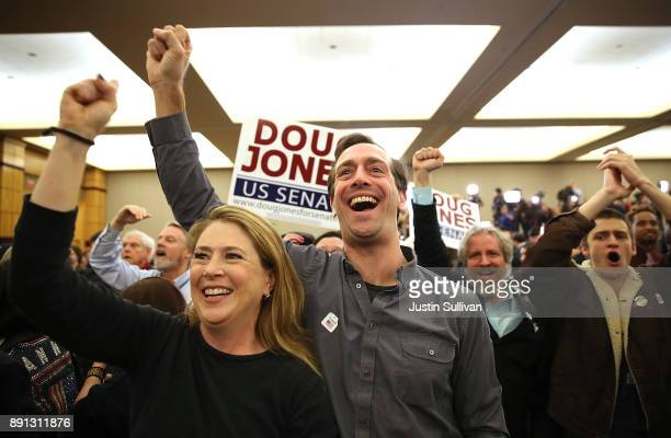 Supporters of democratic US Senator elect Doug Jones celebrate as Jones is declared the winner during his election night gathering the Sheraton Hotel...