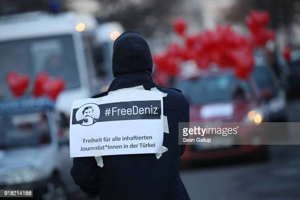 Supporters of Deniz Yucel a GermanTurkish journalist imprisoned in Turkey prepare for a protest tour of cars and bicycles on the first anniversary of...