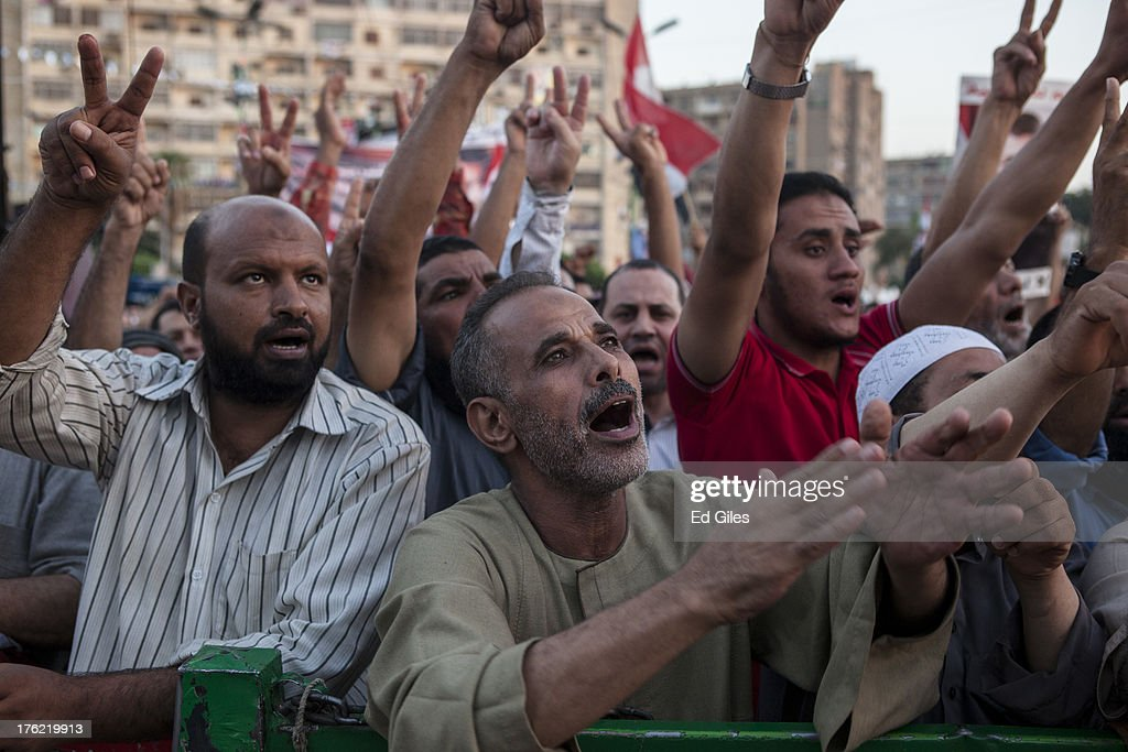 Supporters of deposed Egyptian President Mohammed Morsi attend a sit-in demonstration near the Rabaa al-Adweya Mosque in the Nasr City district on August 12, 2013 in Cairo, Egypt. Egyptian security forces threatened to begin a siege of pro-Morsi protest camps in Cairo overnight on August 11, however Egypt's Interior Ministry appeared to have put off plans to crack down on protesters early on Monday. Morsi supporters have continued to protest at sites across Cairo over one month after the Egyptian military deposed Egypt's first democratically elected President, Mohammed Morsi, on July 3. (Photo by Ed Giles/Getty Images).