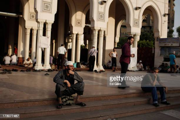 Supporters of deposed Egyptian President Mohammed Morsi gather at the Rabaa al Adweya Mosque in the district of Nasr City on July 6 2013 in Cairo...