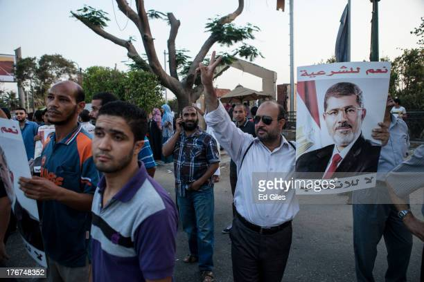 Supporters of deposed Egyptian President Mohammed Morsi gather on the Nile River corniche in the Maadi district to protest the recent killing of...