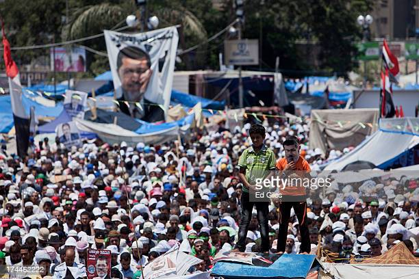 Supporters of deposed Egyptian President Mohammed Morsi take part in a demonstration at the Rabaa al-Adweya mosque in the district of Nasr City on...