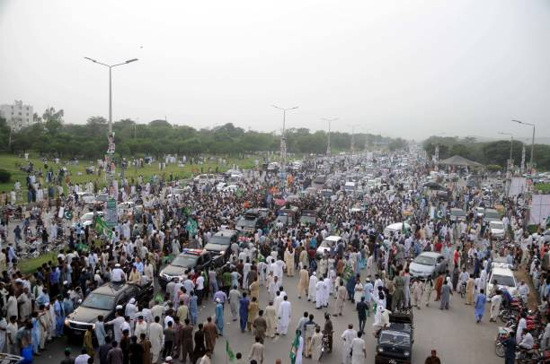 ROAD RAWALPINDI PUNJAB PAKISTAN Supporters of deposed Prime Minister Nawaz Sharif shout slogans during a rally in Islamabad Pakistan`s deposed prime..