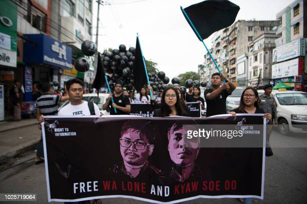 Supporters of detained Myanmar journalists Wa Lone and Kyaw Soe Oo march during a rally in Yangon demanding for their release on September 1 2018 The...