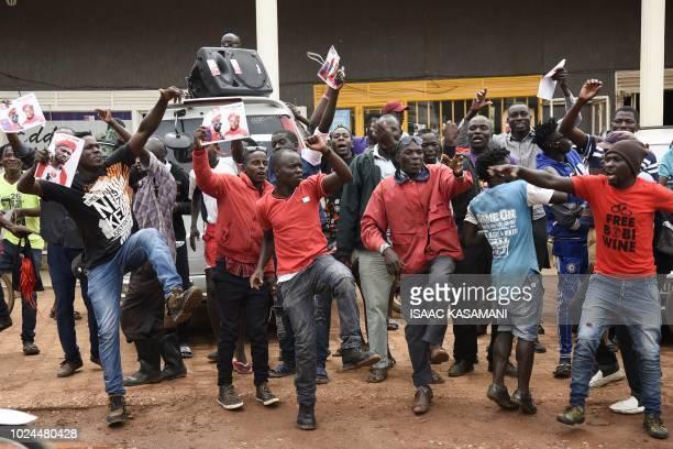 Supporters of detained Ugandan singerturnedpolitician Robert Kyagulanyi aka Bobi Wine react outside Kyagulanyi's recording studios in Kampala's...
