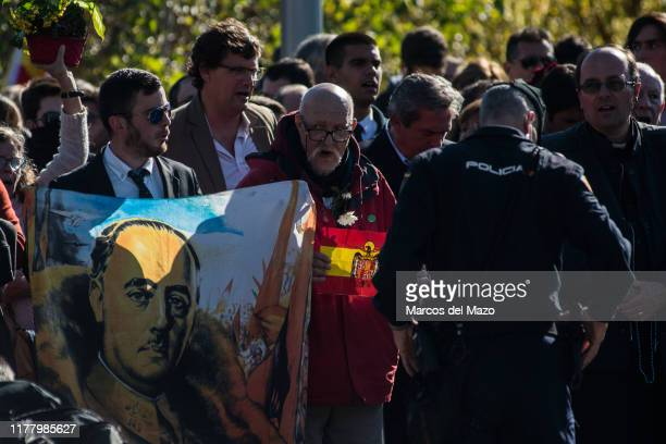 Supporters of dictator Francisco Franco gather to protest near Mingorrubio cemetery after his exhumation. Spain's fascist dictator was exhumed from...