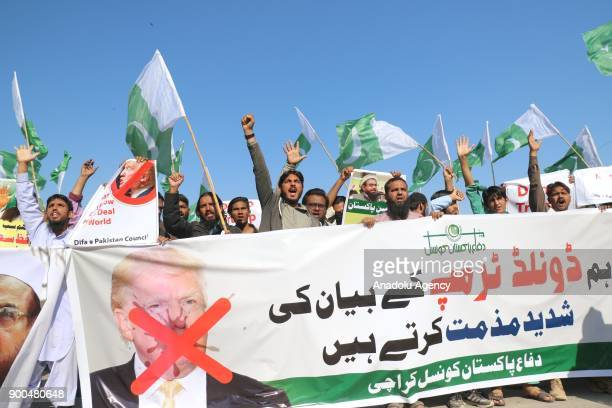 Supporters of DifaePakistan Council chant slogans during a protest against US President Donald Trump's statement against Pakistan in Karachi on...