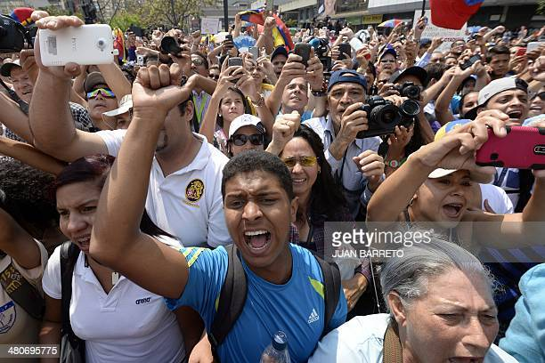 Supporters of dismissed opposition deputy Maria Corina Machado take part in a protest against the Venezuelan government in Caracas on March 26 2014...