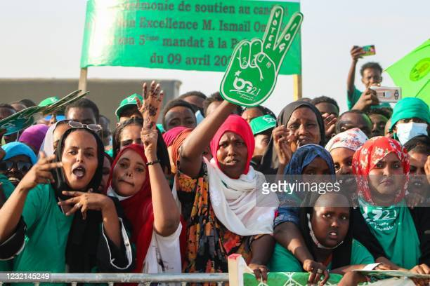 Supporters of Djibouti President Ismail Omar Guelleh gesture during his election campaign in Balbala, Djibouti, on March 29 ahead of the presidential...