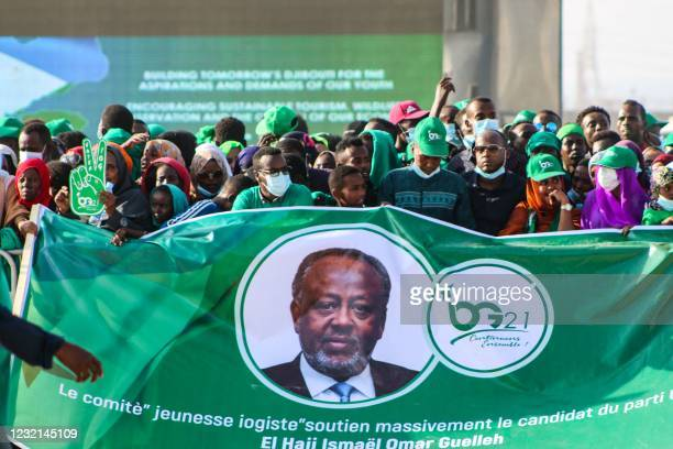 Supporters of Djibouti President Ismail Omar Guelleh hold a banner during his election campaign in Balbala, Djibouti, on March 29 ahead of the...