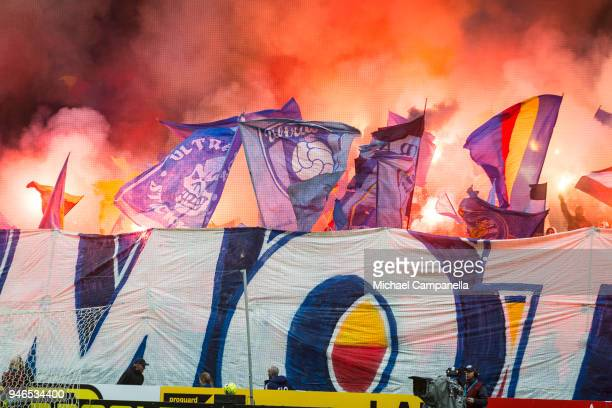 Supporters of Djurgardens IF wave flags and light flares ahead of the Allsvenskan match between AIK and Djurgardens IF at Friends arena on April 15...