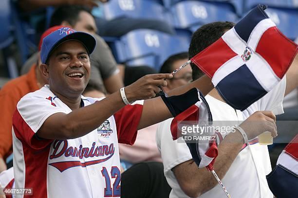 Supporters of Dominican Republic's Tigres de Licey cheer during their 2014 Caribbean baseball series game against Cuba's Azucareros de Villa Clara on...