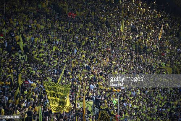 Supporters of Dortmund await the start of the match before the Bundesliga match between Borussia Dortmund and Bayer 04 Leverkusen at Signal Iduna...