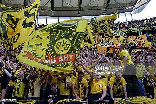 Supporters of Dortmund cheer up during the DFB Cup Final match between Borussia Dortmund and VfL Wolfsburg at Olympiastadion on May 30 2015 in Berlin...