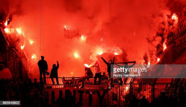 Supporters of Dortmund handle pyrotechnics during the DFB Cup match between 1 FC Magdeburg and Borussia Dortmund at MDCCArena on October 24 2017 in...