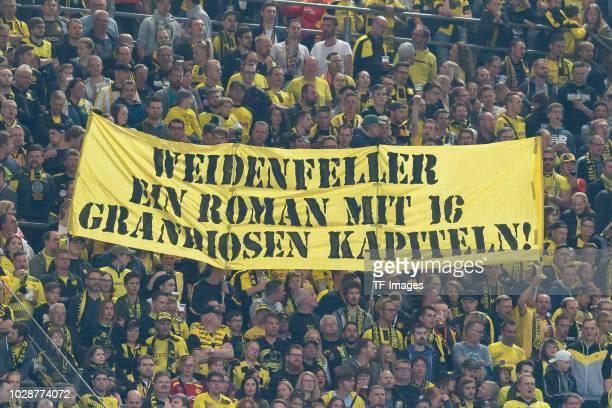 Supporters of Dortmund show aTrainer Juergen Klopp aner for Roman Weidenfeller during the Roman Weidenfeller Farewell Match between BVB Allstars and...