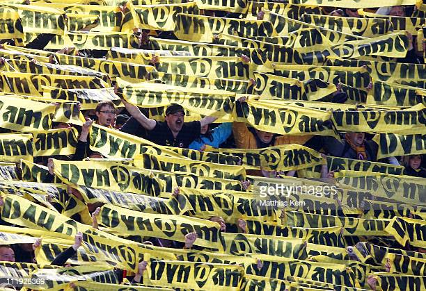 Supporters of Dresden cheer during the Third League match between FC Hansa Rostock and SG Dynamo Dresden at DKB Arena on April 9, 2011 in Rostock,...