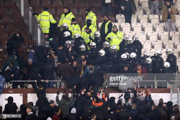 Supporters of Dresden clash with police and security personnel during the Second Bundesliga match between FC St Pauli and SG Dynamo Dresden at...