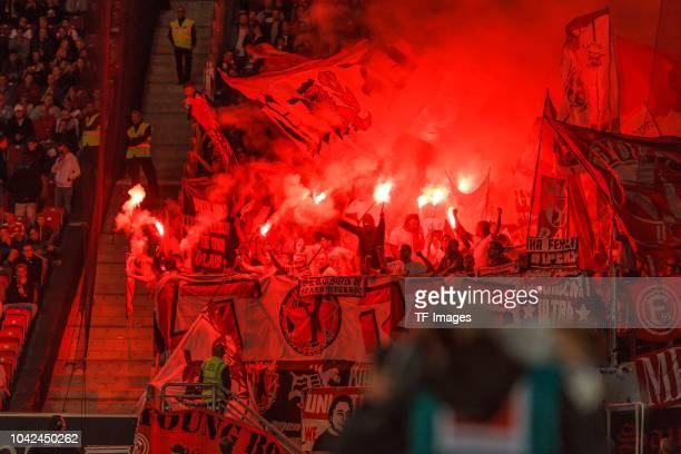 Supporters of Duesseldorf are firing Bengalos during the Bundesliga match between VfB Stuttgart and Fortuna Duesseldorf at MercedesBenz Arena on...