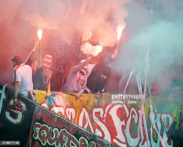 Supporters of Duesseldorf fire smoke bombs prior to the Second Bundesliga match between Arminia Bielefeld and Fortuna Duesseldorf at Schueco Arena on...