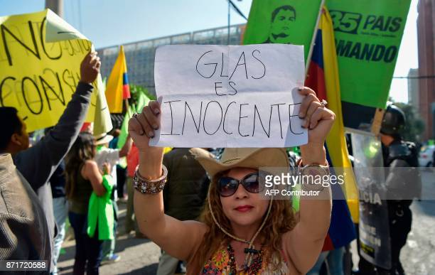 Supporters of Ecuador's suspended Vice President Jorge Glas demonstrate in front of the National Court of Justice during a hearing where the...