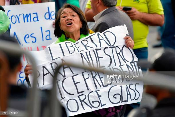 Supporters of Ecuador's vice president Jorge Glas demonstrate outside the National Court of Justice during the sentencing hearing in Quito Ecuador on...