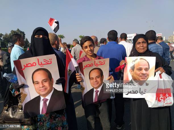 Supporters of Egyptian President Abdel Fattah alSisi rally near the Unknown Soldier Memorial in Egypt's capital Cairo's eastern Nasr City district on...