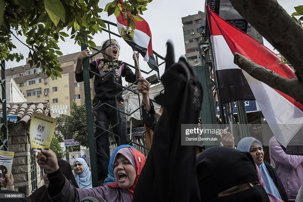 Supporters of Egyptian President Mohamed Morsi and members of the Muslim Brotherhood chant slogans during a rally on December 14, 2012 in Cairo, Egypt. Opponents and supporters of Egyptian President Mohamed Morsi staged final rallies in Cairo ahead of tomorrow's referendum vote on the country's draft constitution that was rushed through parliament in an overnight session on November 29. The country's new draft constitution, passed by a constitutional assembly dominated by Islamists, will go to a referendum vote on December 15.