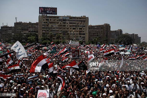 Supporters of Egyptian President Mohammed Morsi chant during a demonstration at the Rabaa al-Adaweya Mosque in the suburb of Nasr City on June 30,...