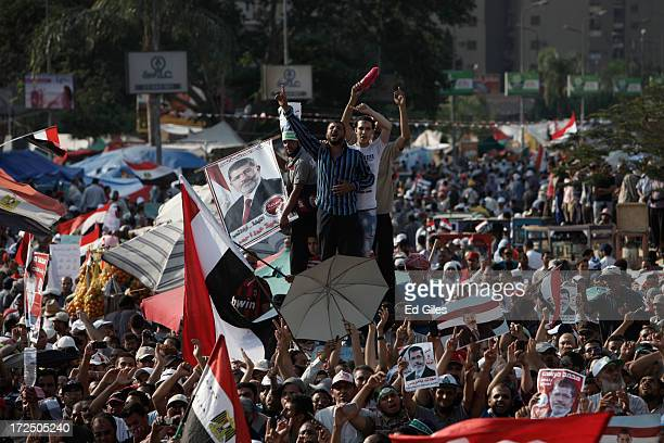 Supporters of Egyptian President Mohammed Morsi demonstrate at the Rabaa al Adawiya Mosque in the suburb of Nasr City on July 2, 2013 in Cairo,...
