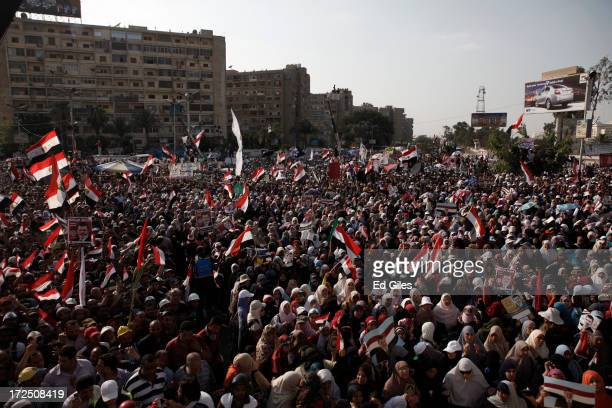 Supporters of Egyptian President Mohammed Morsi demonstrate at the Rabaa al Adawiya Mosque in the suburb of Nasr City on July 2 2013 in Cairo Egypt...