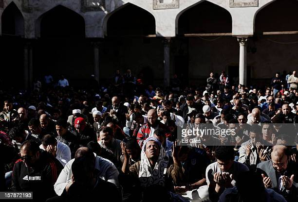 Supporters of Egyptian President Mohammed Morsi pray during a funeral service for three Muslim Brotherhood members killed in clashes with antiMorsi...