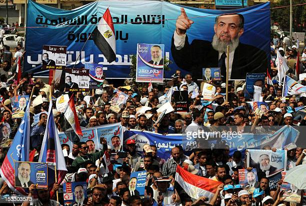 Supporters of Egyptian Salafist candidate Hazem Abu Ismail hold his posters at Tahrir Square in Cairo on April 6 2012 during a protest against a...