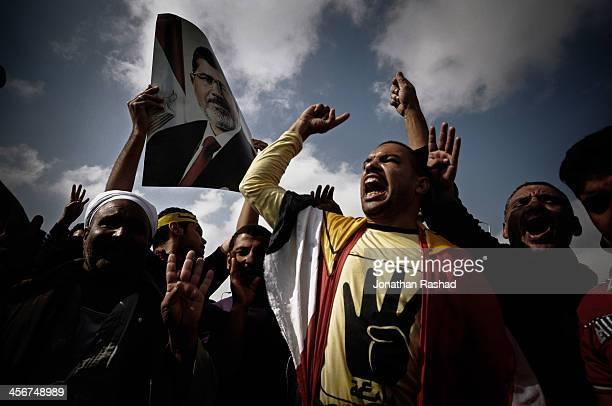 Supporters of Egypt's deposed president Mohamed Morsi chant outside Police Academy in Cairo awaiting Morsi's trial. 4 November 2013 - On November 4th...