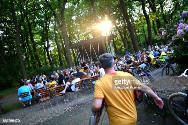 Supporters of Eintracht Braunschweig sit outside a public viewing area prior the Bundesliga Playoff Leg 2 between Eintracht Braunschweig and VfL...