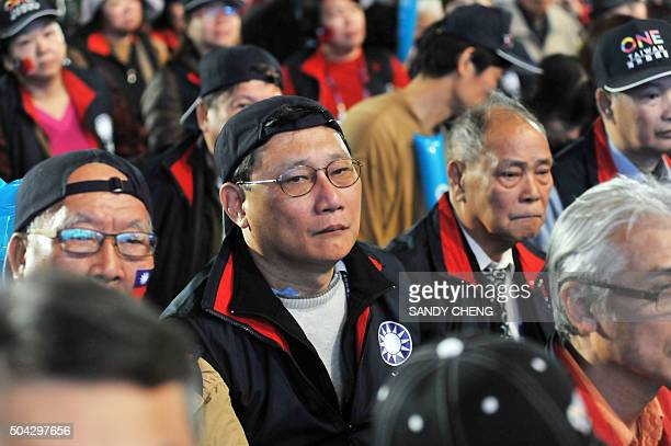 Supporters of Eric Chu, the presidential candidate for the ruling Kuomintang party, listen as they attend a campaign rally ahead of the January 16...