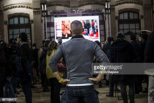 Supporters of Esquerra Republicana de Catalunya' ERC watch election results unfolding on TV show at the party election night rally as final results...