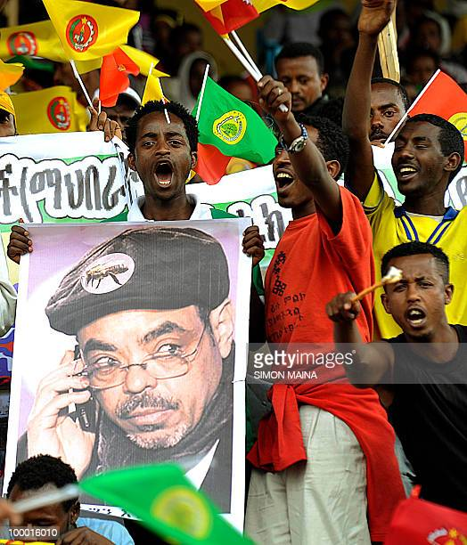 Supporters of Ethiopia People Revolutionary Front carry a poster of Prime Minister Meles Zenawi on May 20 during the last day of campaign ahead of an...
