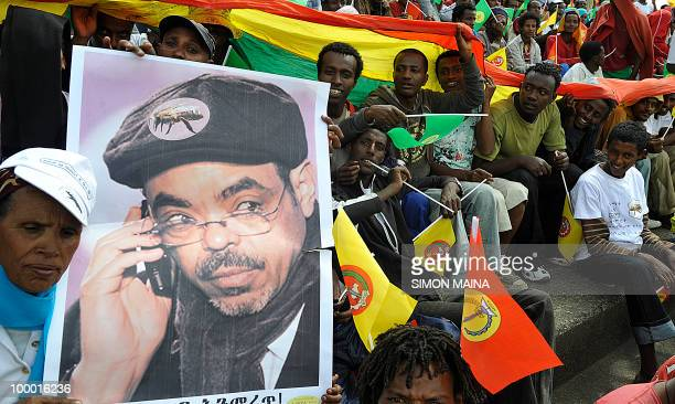 Supporters of Ethiopia People Revolutionary Front hold a poster bearing Ethiopian Prime Minister Meles Zenawi 20 May 2010during the last day of...