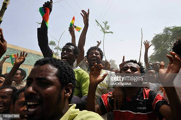 Supporters of Ethiopian Prime Minister Meles Zenawi sing and dance as he arrives on May 23 2010 to cast his vote at a polling station in Adwa 900 kms...