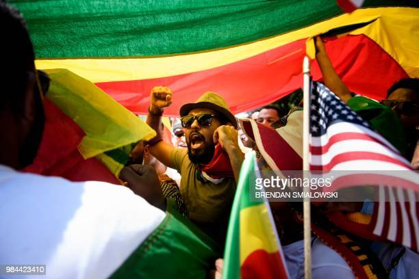 Supporters of Ethiopia's Prime Minister Abiy Ahmed rally for US support outside the State Department on June 26, 2018 in Washington, DC.